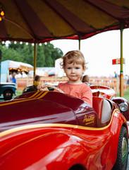 UK, Young boy on fairground ride