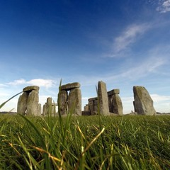United Kingdom, England, Wiltshire, Amesbury, Surface-level shot of Stonehenge against sky with grass stems in foreground