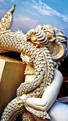 Thailand, North East, Close-up of mythical lion statue in Buddhist temple