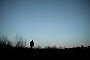 USA, Utah, Silhouette of woman walking at dusk