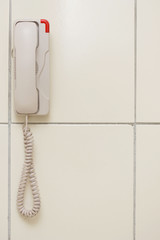 Malaysia, White phone hanging on wall