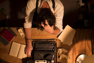 USA, Idaho, Bannock County, Pocatello, Writer sitting at desk unable to write