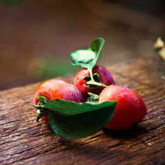 Close up of plums on wooden table