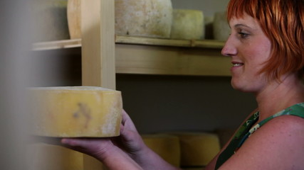 HD1080p: Close up of a woman demonstrating cheese to her guests