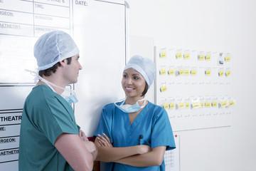 Two surgeons talking in hallway of hospital emergency unit