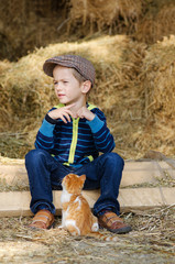 Little boy (4-5) with kitten