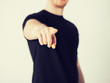 man pointing his finger at you