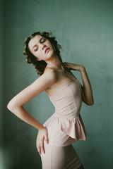 Cute teenage girl (14-15) in peachy dress