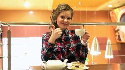 Youg beautiful women drinking tea in restourant