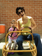 Mother and daughter (18-23 months) driving cart