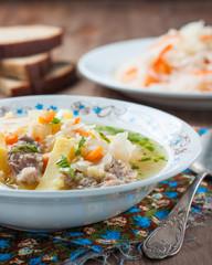 Russian cuisine. Sauerkraut soup with rye bread