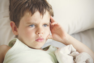 Pensive looking boy (4-5)