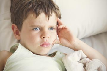 Pensive looking boy (4-5)