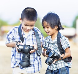 India, New Delhi, Boys holding cameras