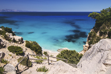 Italy, Sardinia, Rocky coast and calm sea