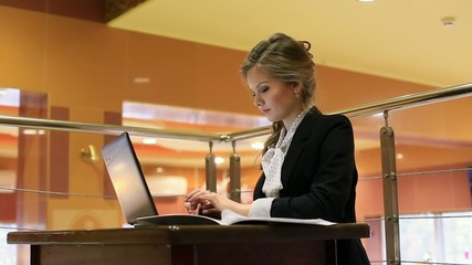 Youg pretty women working at laptop in cafe and smiling