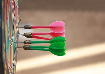 Darts in dartboard