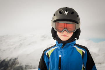 Young skier on winter background