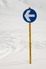 Arrow in the ski slope sign