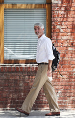 Businessman walking past building