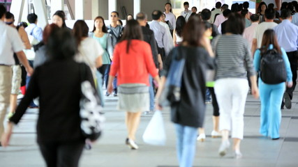 Asian Streets Busy with Walking Commuters