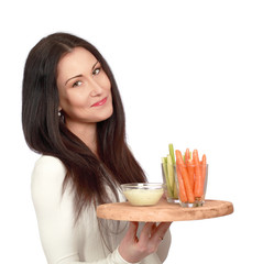 Pretty lady with healthy snack, holding veggie dip