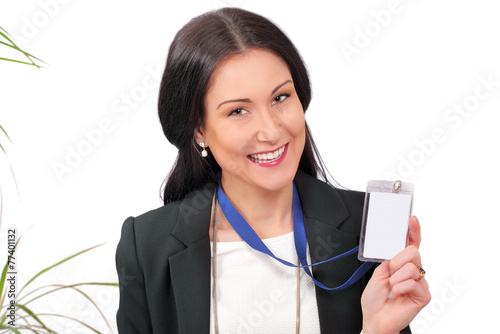 Happy business delegate showing her ID - 77401132