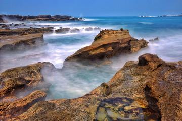 Indonesia, Sawarna, Karang Taraje, Strong waves flowing into rocks