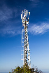 Mast is to accommodate cellular antennas on blue sky background