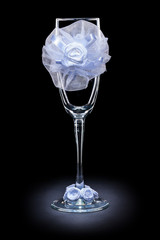 wedding ornated empty wineglass on black background