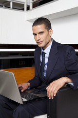 Businessman in office using laptop