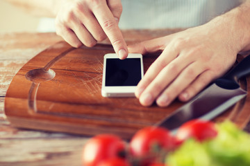 closeup of man pointing finger to smartphone