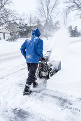 Man Removing Snow With a Snowblower