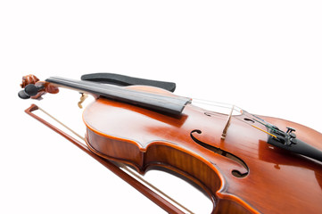 Classic violin with the fiddlestick isolated on white.