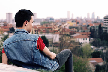 Italy, Lombardy, Milan, Man looking at cityscape