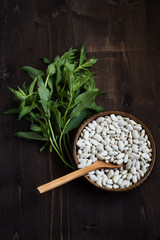 Beans and mint on table