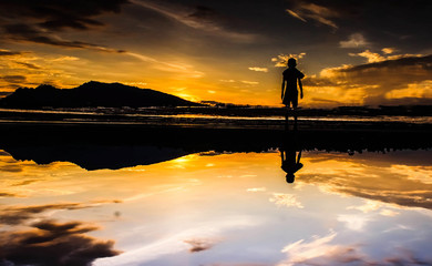 Bangladesh, Sylhet, Silhouette of man looking at sunset