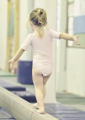 Girl (2-3) on balance bar