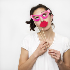 Woman holding lips and glasses masks