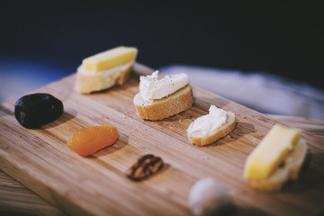 Sandwiches and dried fruits on cutting board