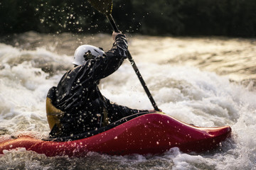 USA, Colorado, Clear Creek, Close-up shot of man kayaking in white water