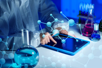 close up of scientist with tablet pc in laboratory