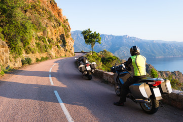 Motorcyclist on mountain road