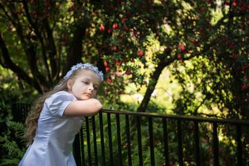 First communion girl (8-9) on bridge