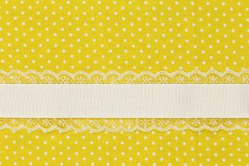 Yellow retro polka dot textile background with ribbon