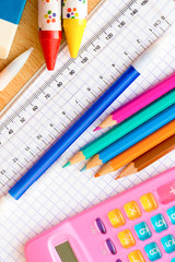 School supplies on a wood background