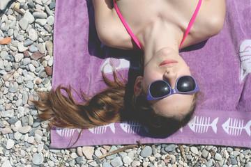Girl (12-13) sunbathing