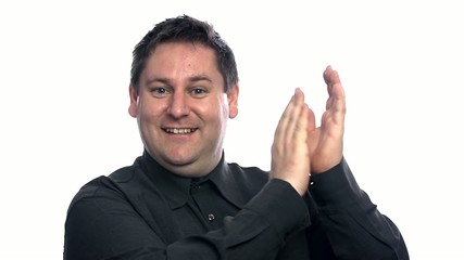 Smiling man clapping with his hands