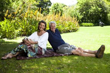 Senior Couple Sitting in the garden