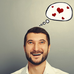 man with speech bubble and red hearts